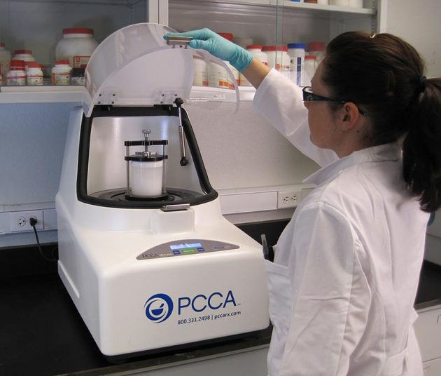 Pharmacist with PCCA RAM Acoustic Compounding Mixer